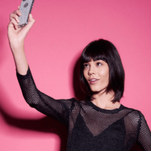 Woman with bangs taking a selfie